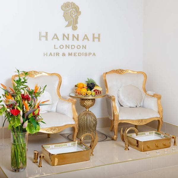 salon in colindale two golden pedicure chairs with fresh fruit and flower displays