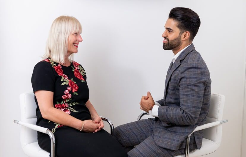 fat freezing in london dr kaywaan khan and a female client of hannah london sitting down having a consultation